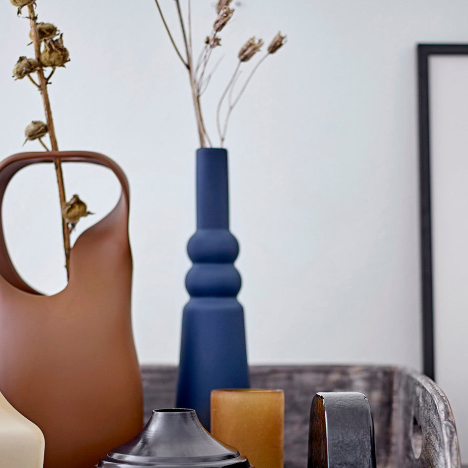 Isolde vase, tall, blue matte latex glaze vase, styled with other decorative items on a sideboard.
