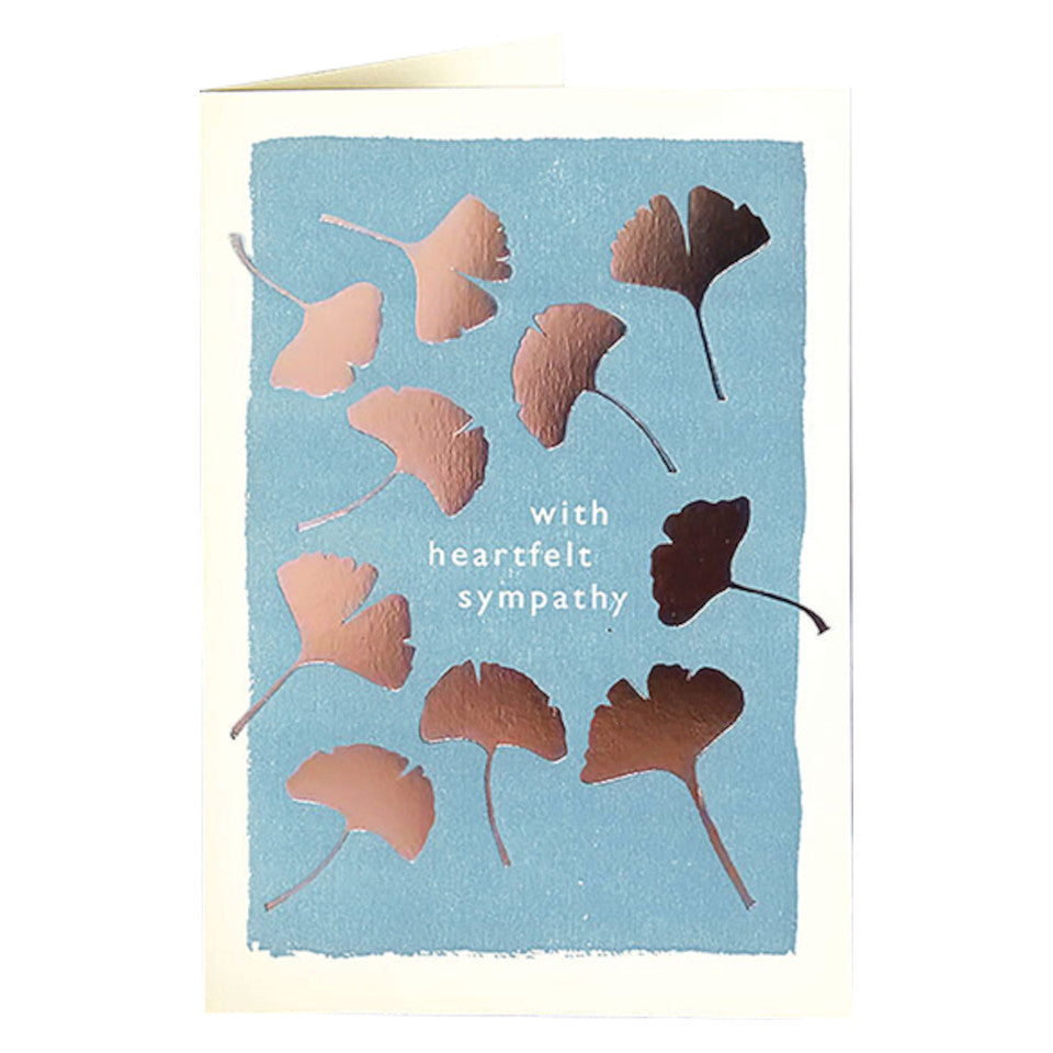 With Heartfelt Sympathy, blank card, with gold gingko leaves on a pale blue background, with white envelope.