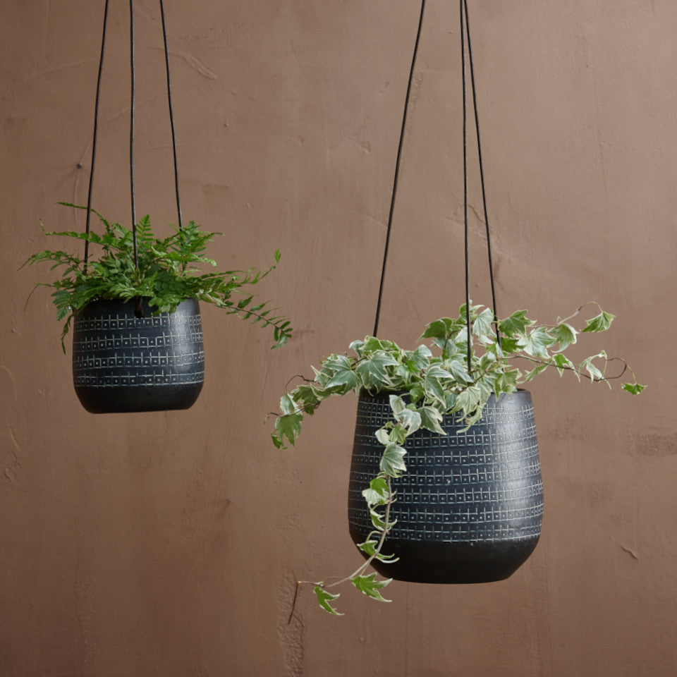 Mahika black metal hanging planter with etched design, l-r. small-large styled hanging with plants.