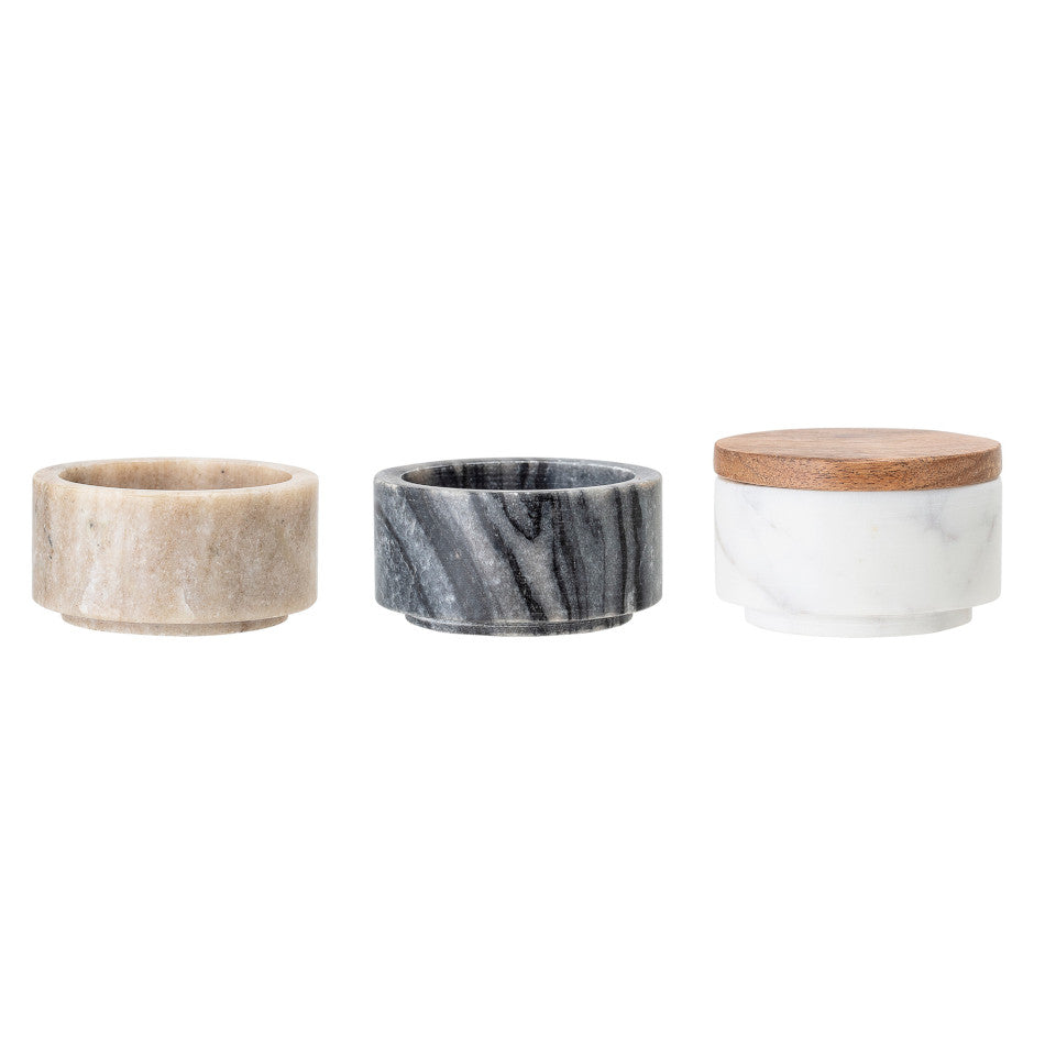 Marble triple jar separated, l-r, rose marble jar, black marble jar, and white marble jar with acacia lid.
