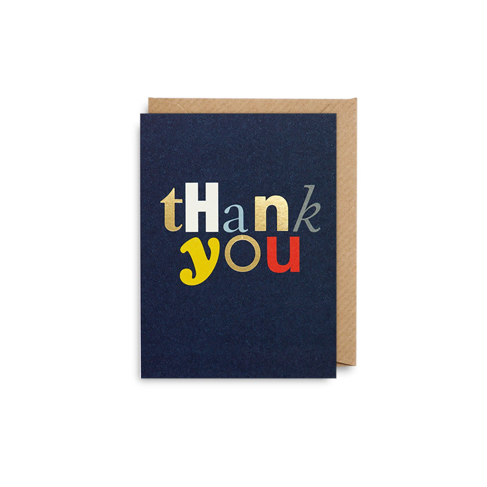 Thank You blank greeting card, gold and coloured different font/style lettering on a navy background, with brwon kraft envelope.