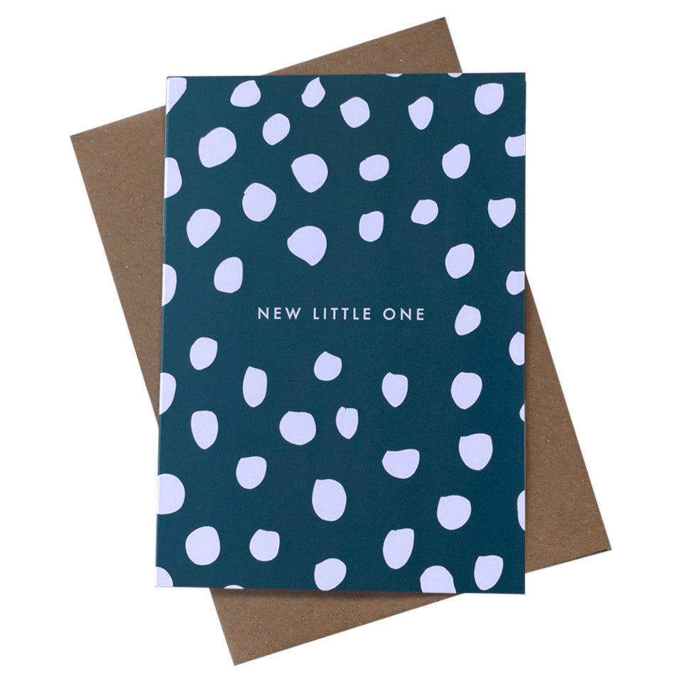 New Little One white spots on a blue background with white text, with brown kraft envelope.