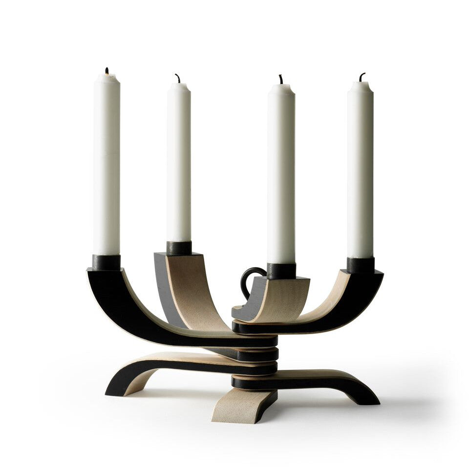 Nordic 4-arm black candle holder, open with candles.