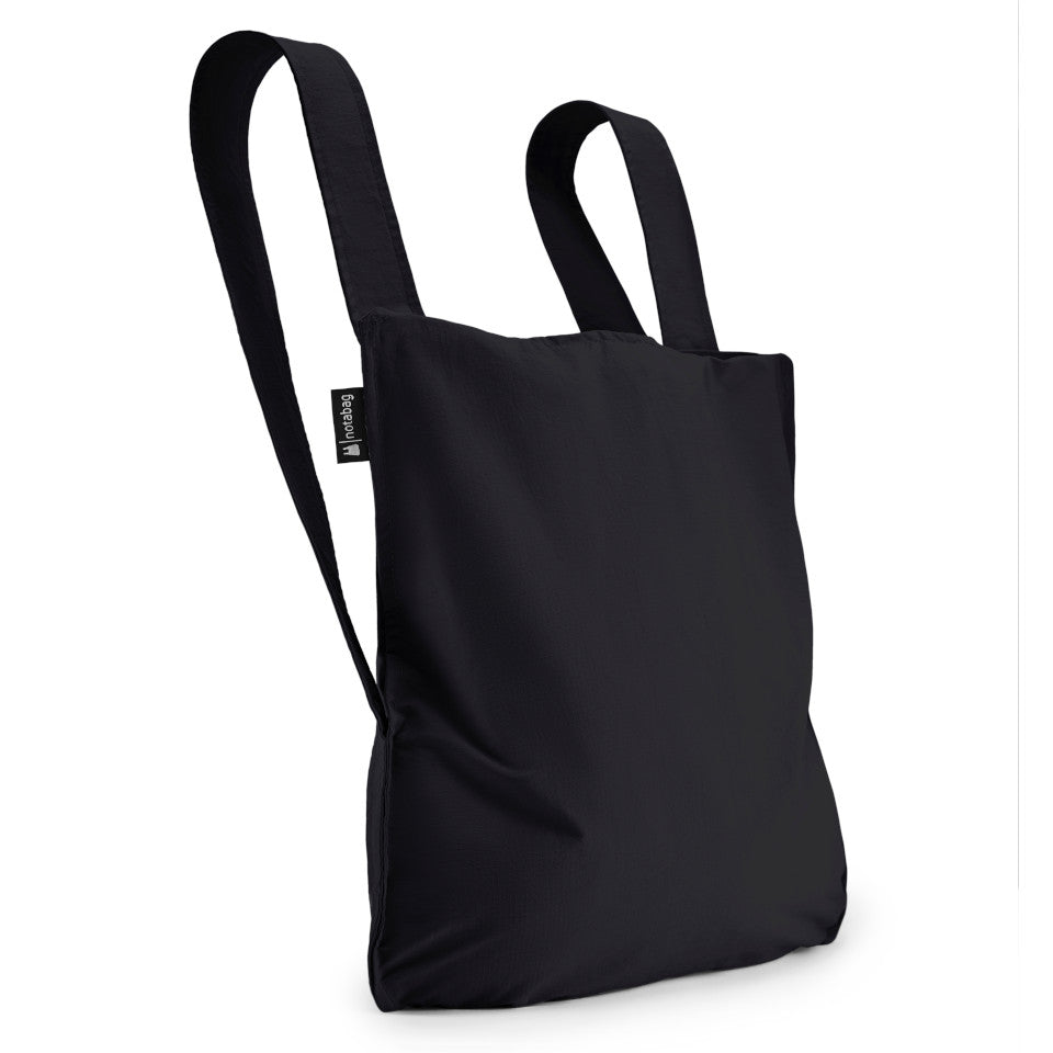 Not-a-bag re-usable fold-away pouch, black, shown as backpack.