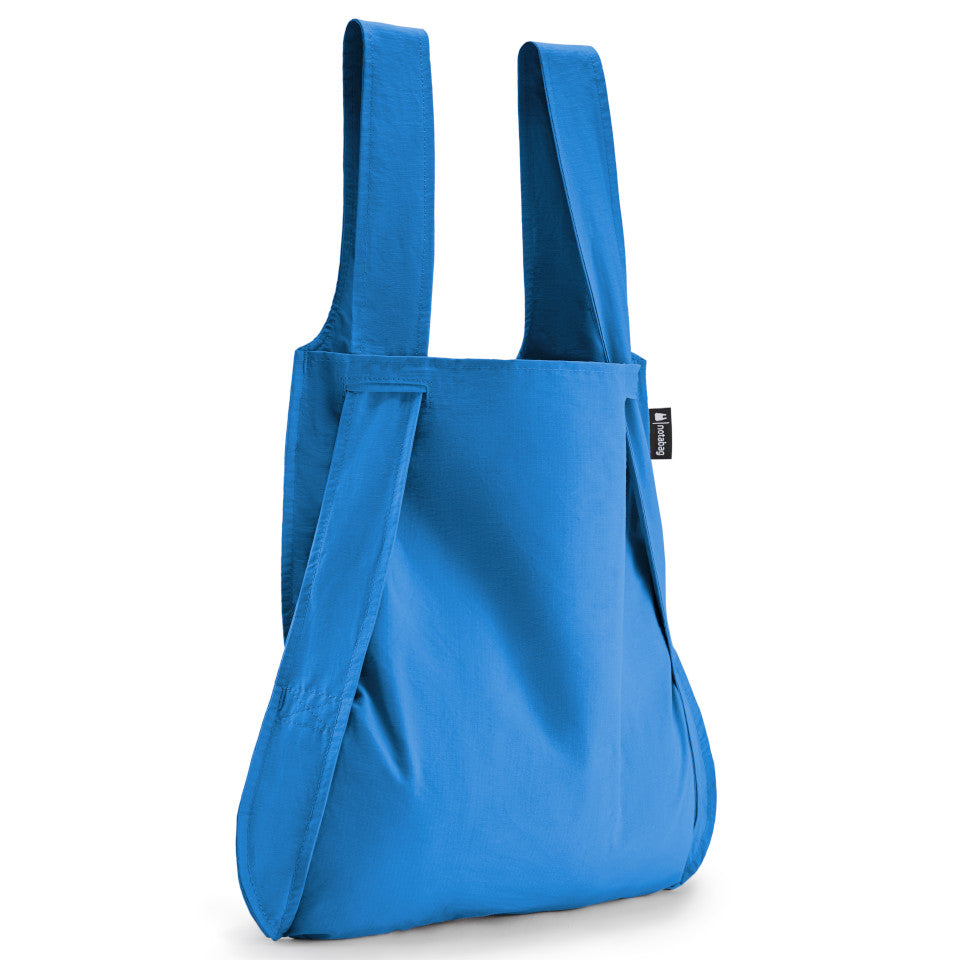 Not-a-bag re-usable fold-away pouch, blue, shown as shopping bag.