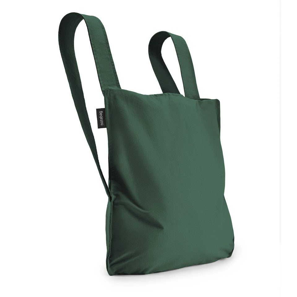 Not-a-bag re-usable fold-away pouch, forest green, shown as backpack.