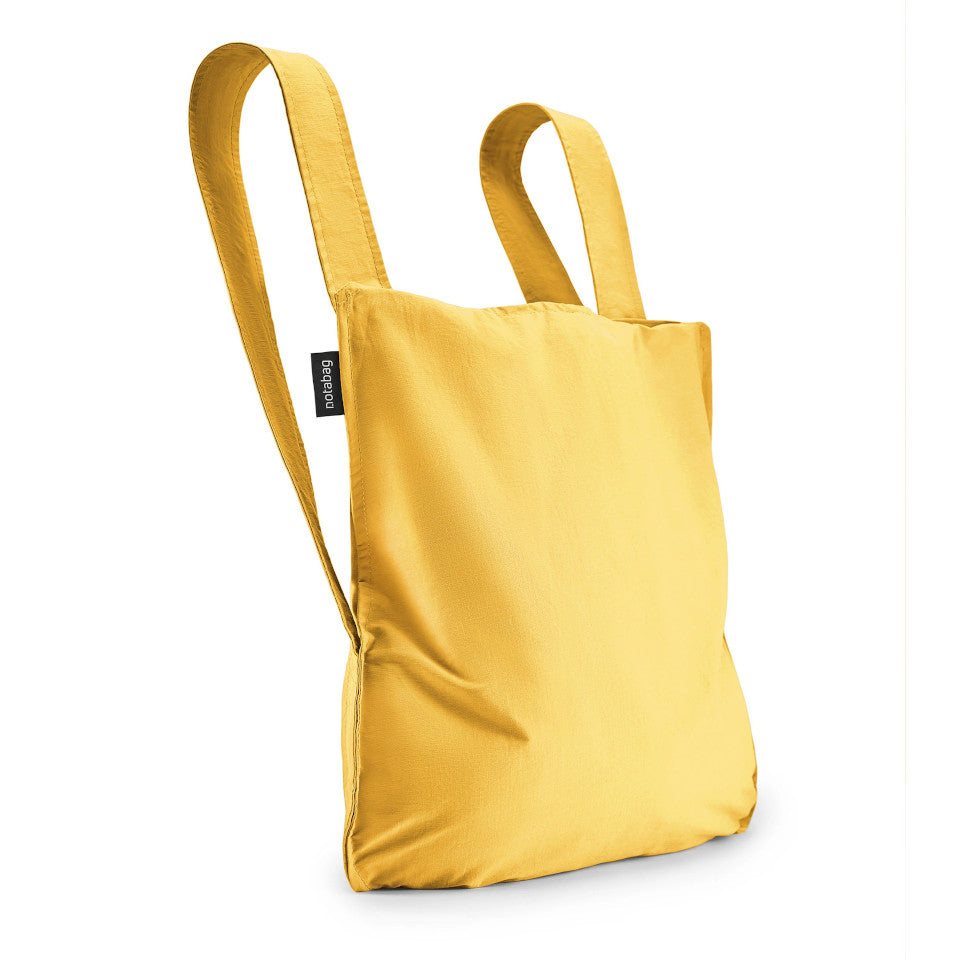 Not-a-bag re-usable fold-away pouch, golden, shown as backpack.