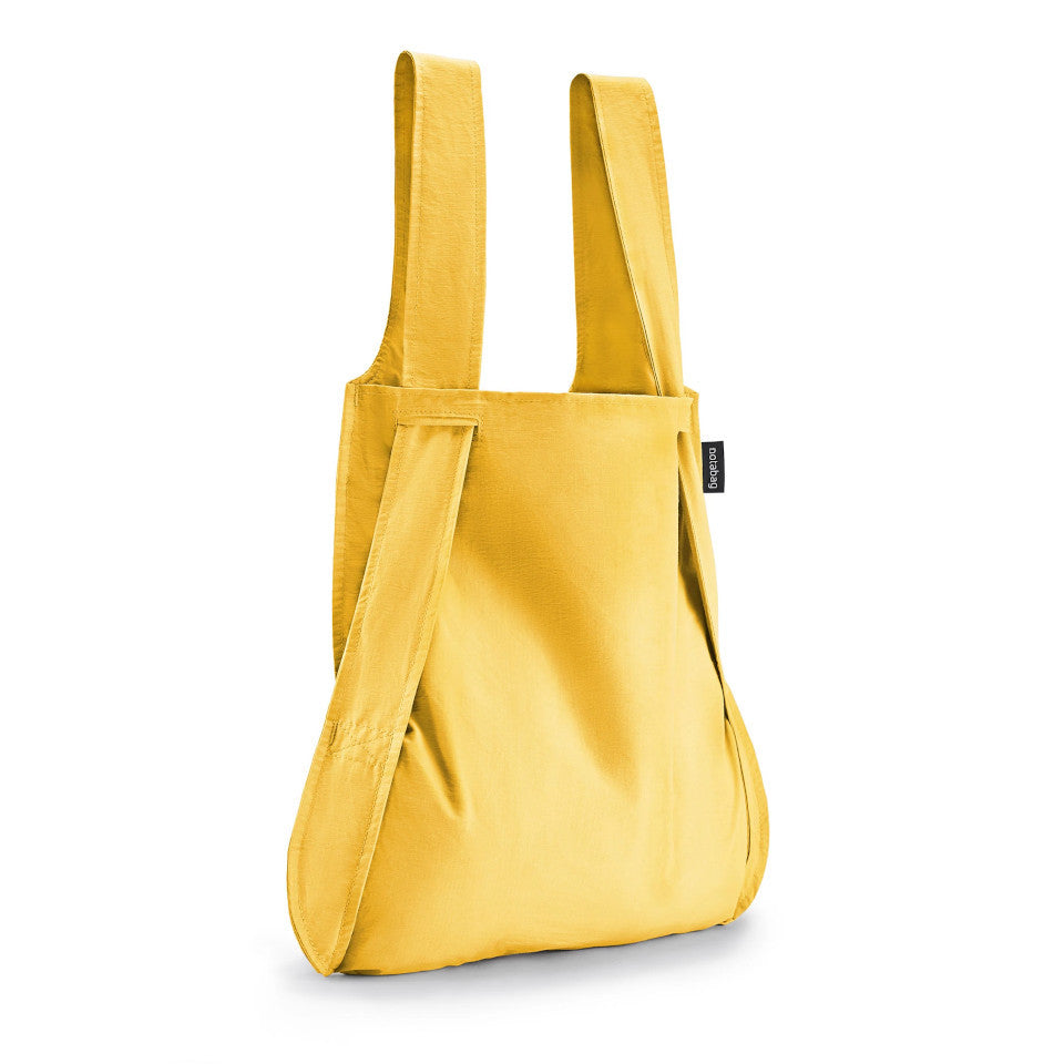 Not-a-bag re-usable fold-away pouch, golden, shown as shopping bag.