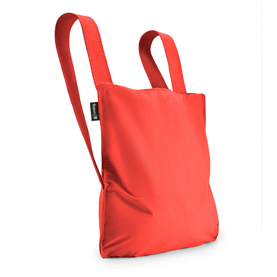 Not-a-bag re-usable fold-away pouch, red, shown as backpack.