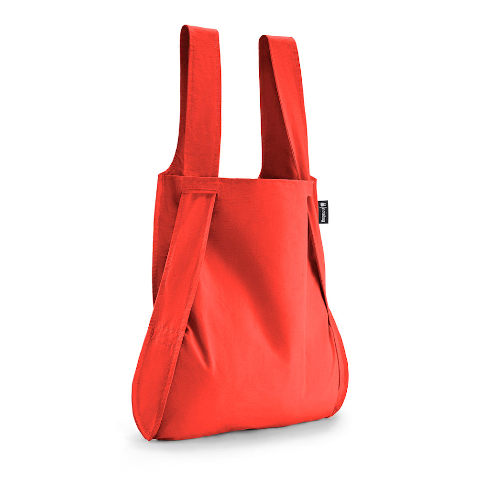 Not-a-bag re-usable fold-away pouch, red, shown as shopping bag.