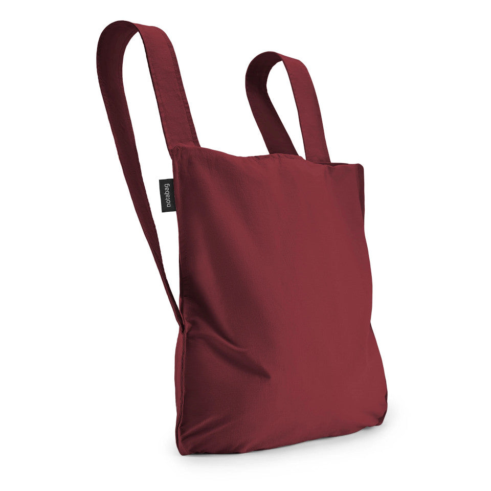 Not-a-bag re-usable fold-away pouch, wine, shown as backpack.