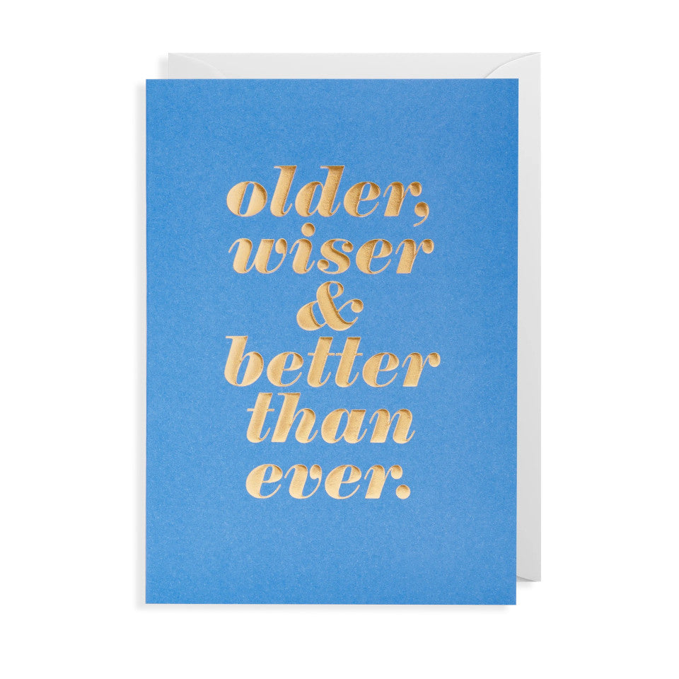 Older, wiser & better than ever., blank birhday card, gold lettering on a blue background, with white envelope.