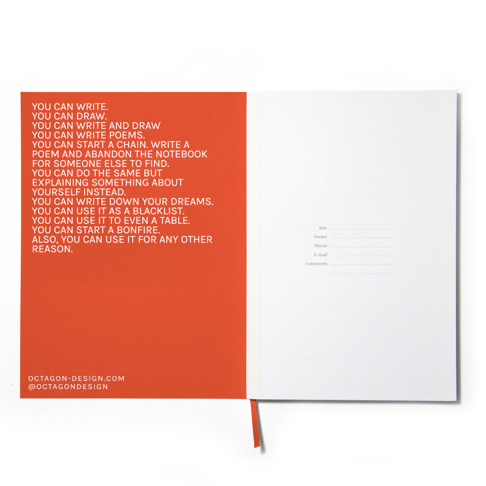 PRIVATE orange notebook with white lettering, inside page detail.