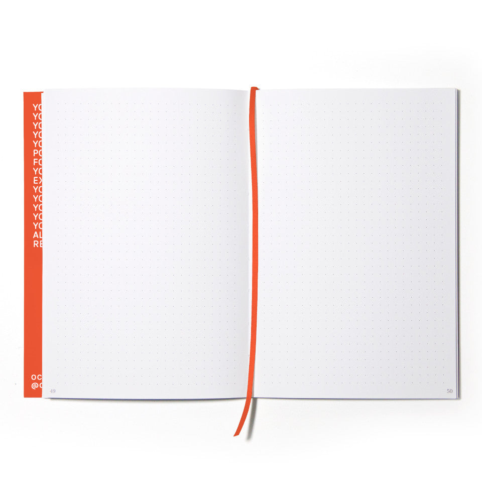 PRIVATE orange notebook with white lettering, open showing dotted pages.