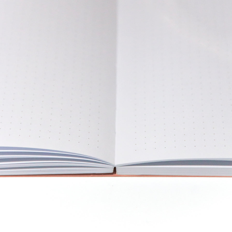 PRIVATE orange notebook with white lettering, detail of pages.