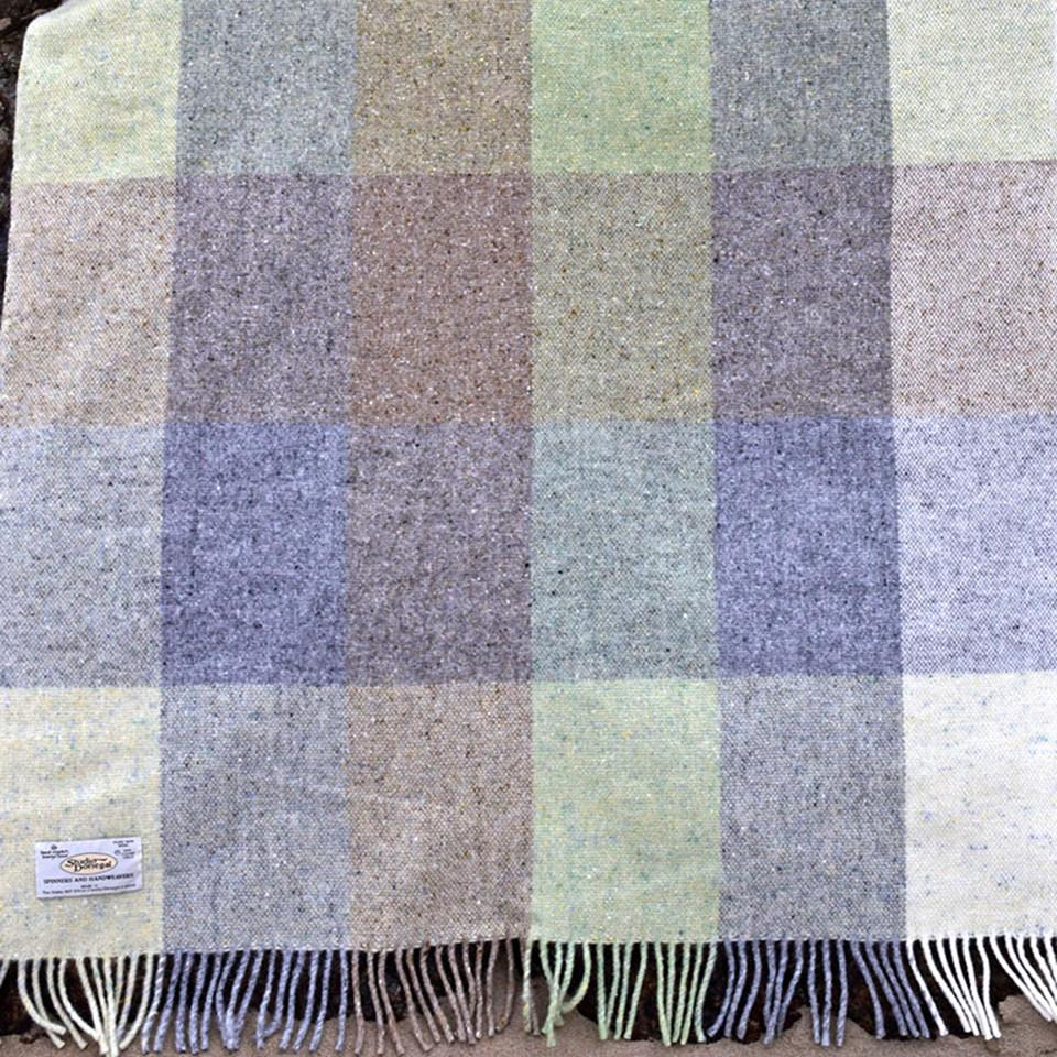 Studio Donegal Sampler small wool throw, pastel green, and pale grey check.