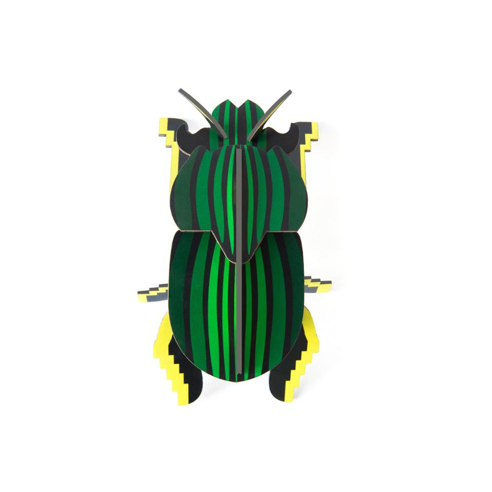 Scarab beetle cardboard decorative object.