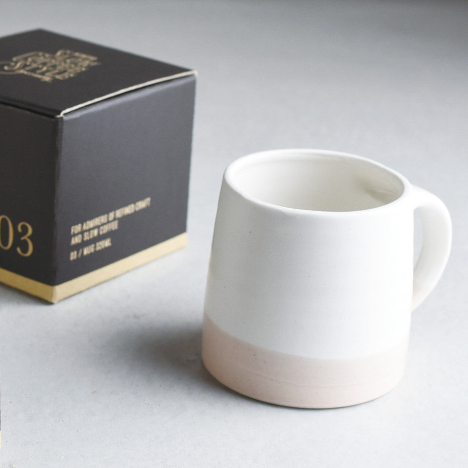 SCS (Slow Coffee Style) S03 white / pink coffee mug with box in the background.