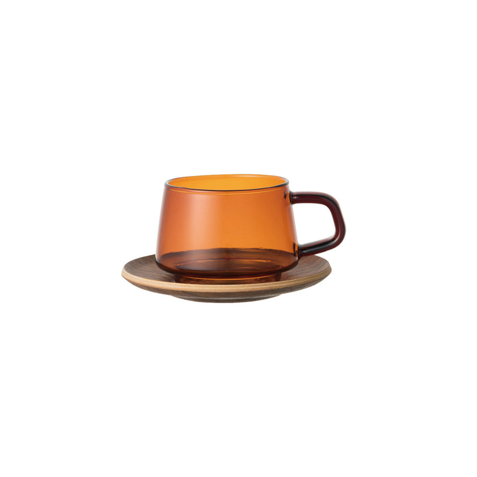 Sepia glass teacup with teak saucer.