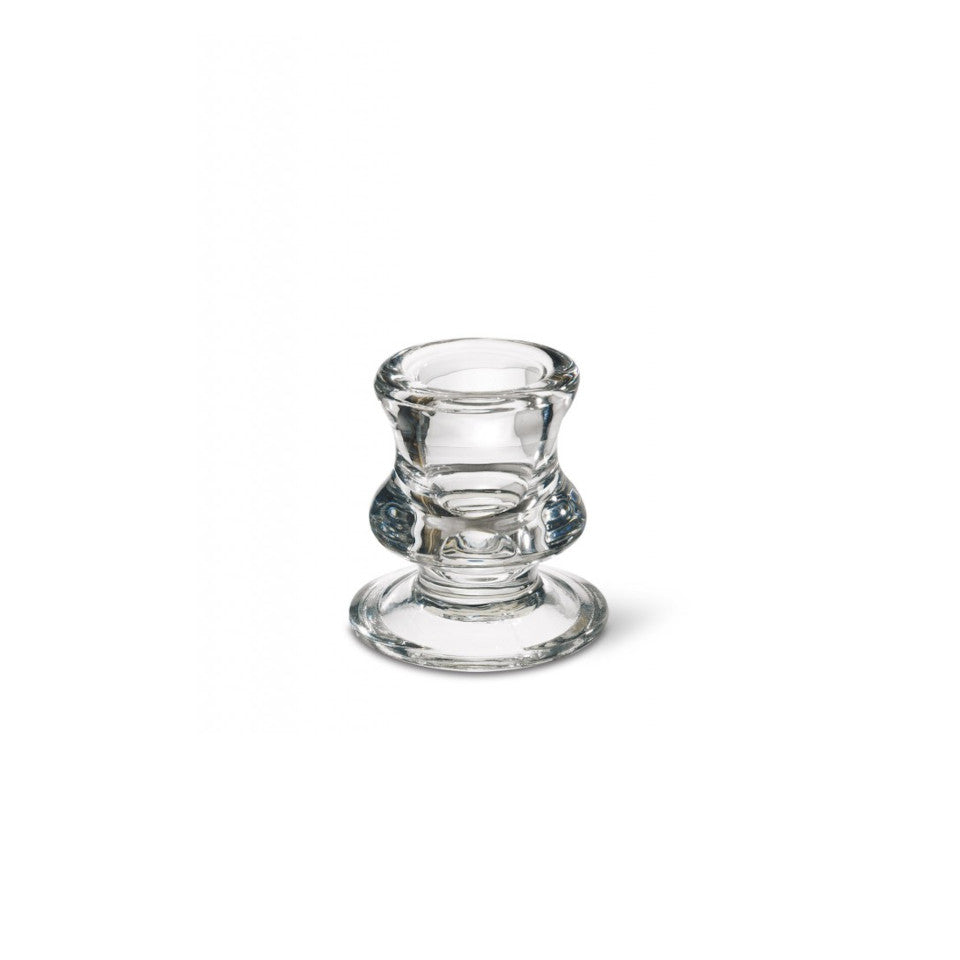 Small glass candleholder for single dinner candle.