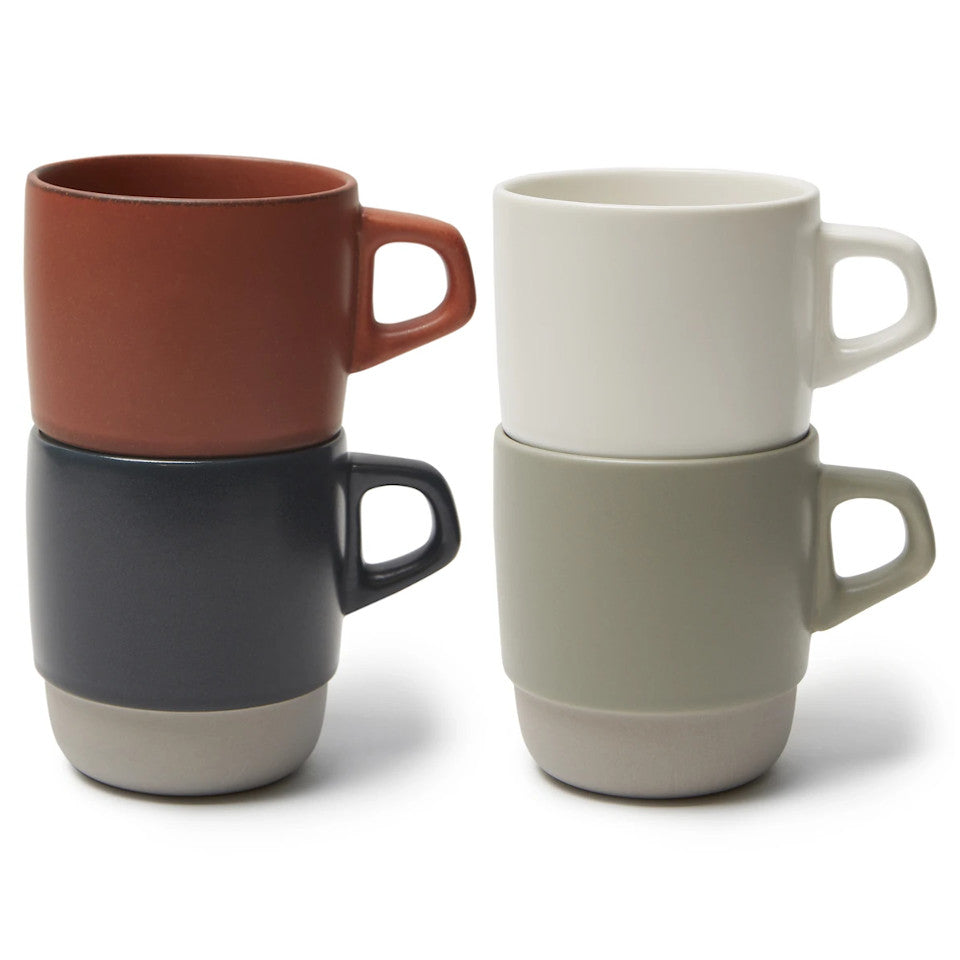 SCS stacking mugs, stacked in pairs, orange stacked in navy and white stacked in grey,