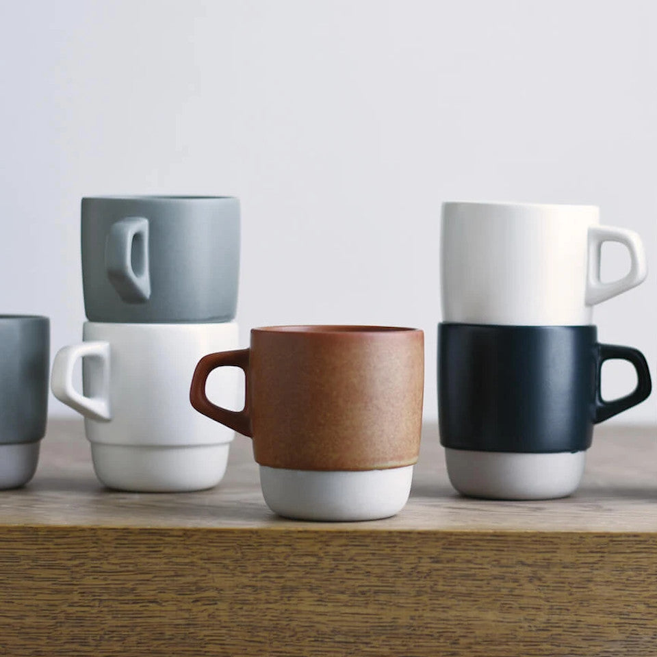 SCS stacking mugs, stacked and styled on a sideboard.
