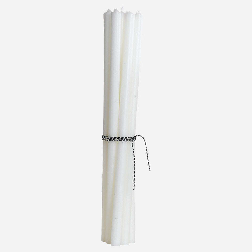 Off-white 30 cm taper candles in a bundle.