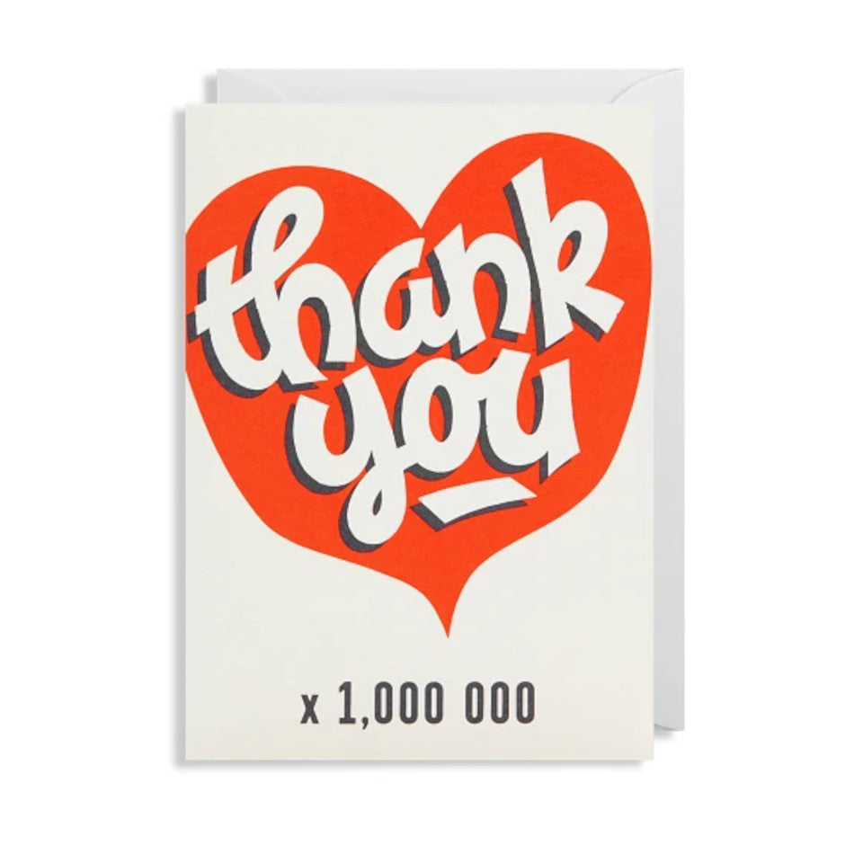 Thank you x 1000000, blank greeting card, thank you on a red heart with 'x 1,000000' underneath, with white envelope.
