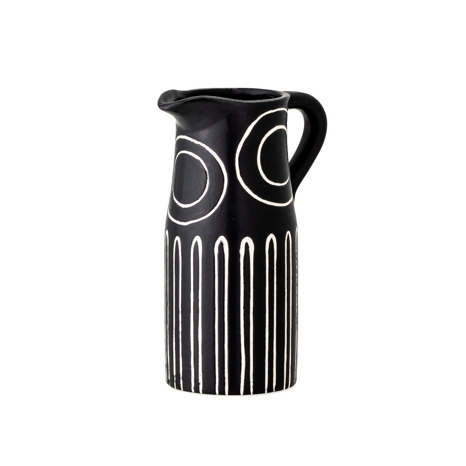 Troy vase, black terracotta jug shape, with white circle and narrow arch pattern, angled view.