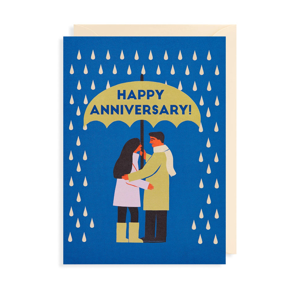 Hapy Anniversary, blank anniversary card, blue lettering across an umbrella, with couple sheltering underneath from a rain shower, on a blue background, with cream envelope.