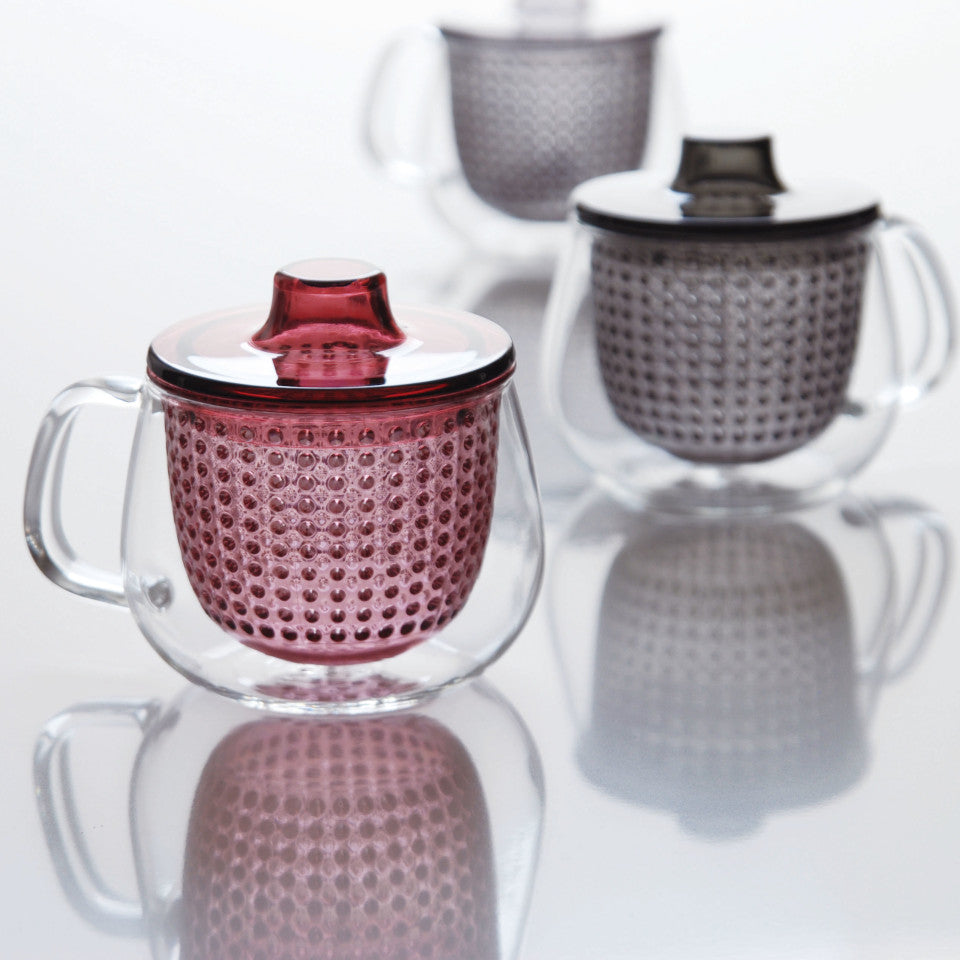 Unimug glass mug with, l-r, red and grey strainer and lid, styled.