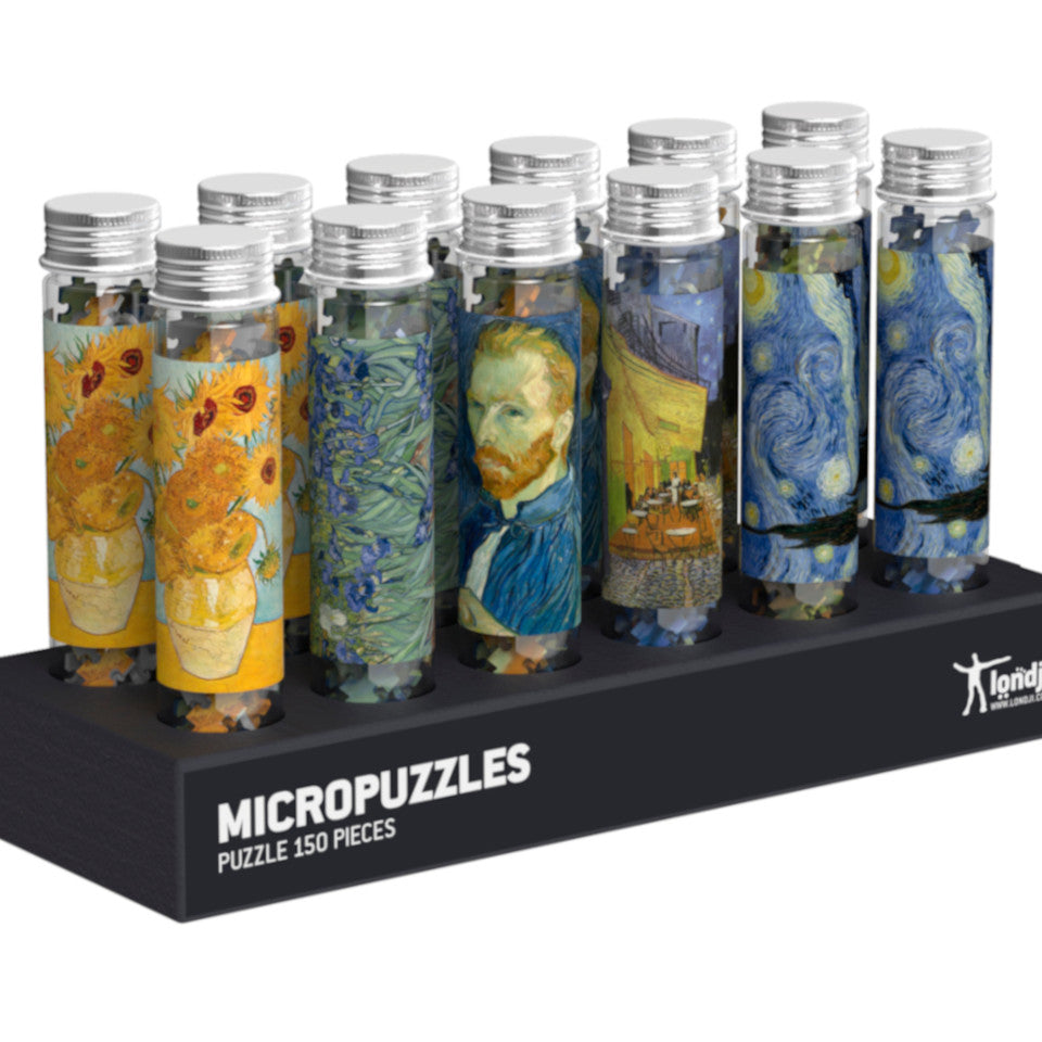 Van Gogh micropuzzle mix, l-r: Sunflowers, Irises, Self-portrait, Terrace of a cafe, and Starry Night.