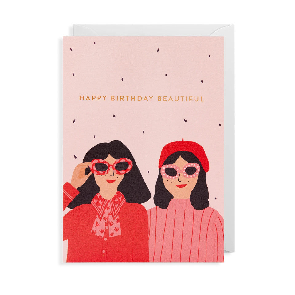 Happy Birthday Beautiful, Jennifer Bouron designed blank birthday card, with two women in sunglasses in reds and pinks, with white envelope.