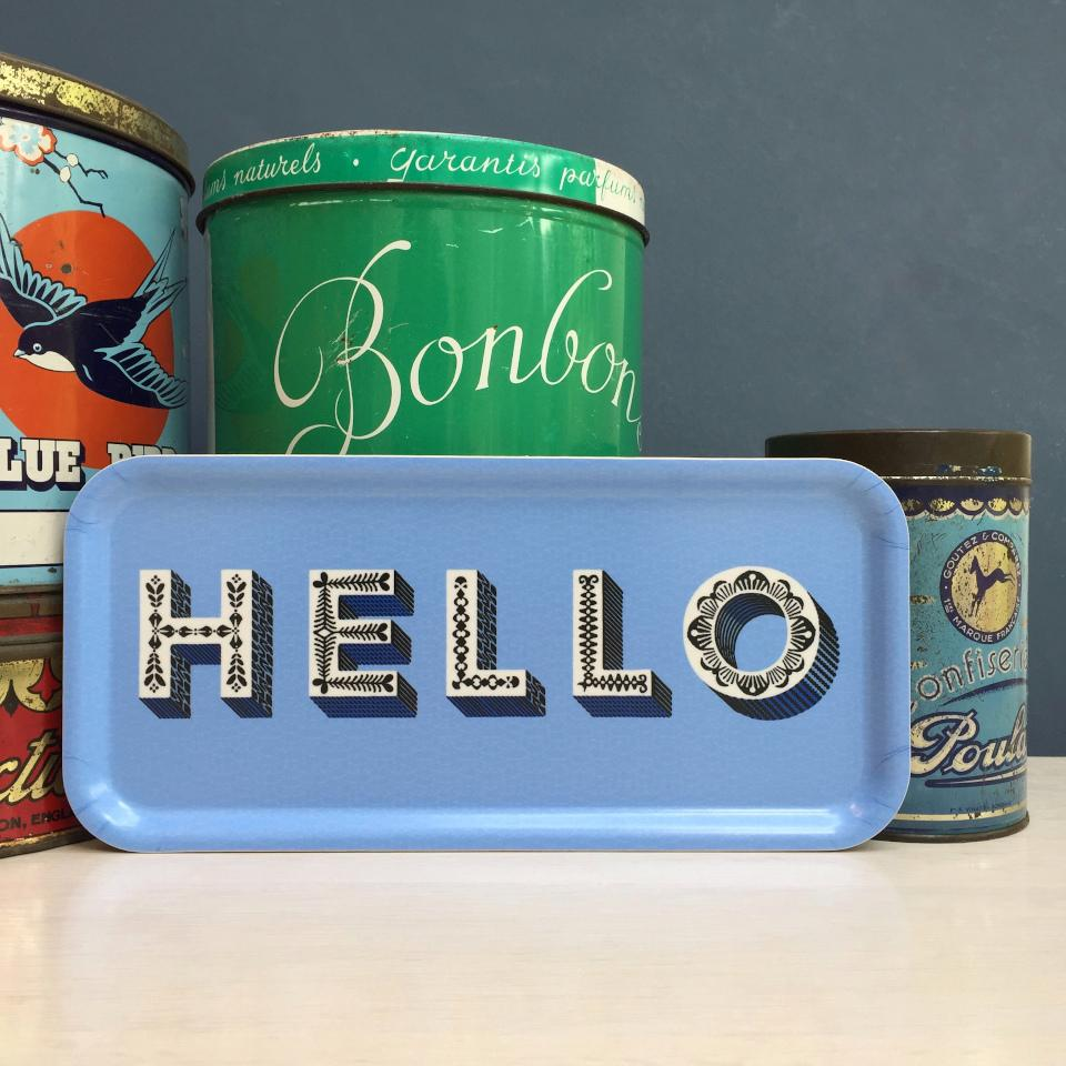 HELLO by Asta Barrington, oblong tray, 32 cm x 15 cm, styled with storage canisters.