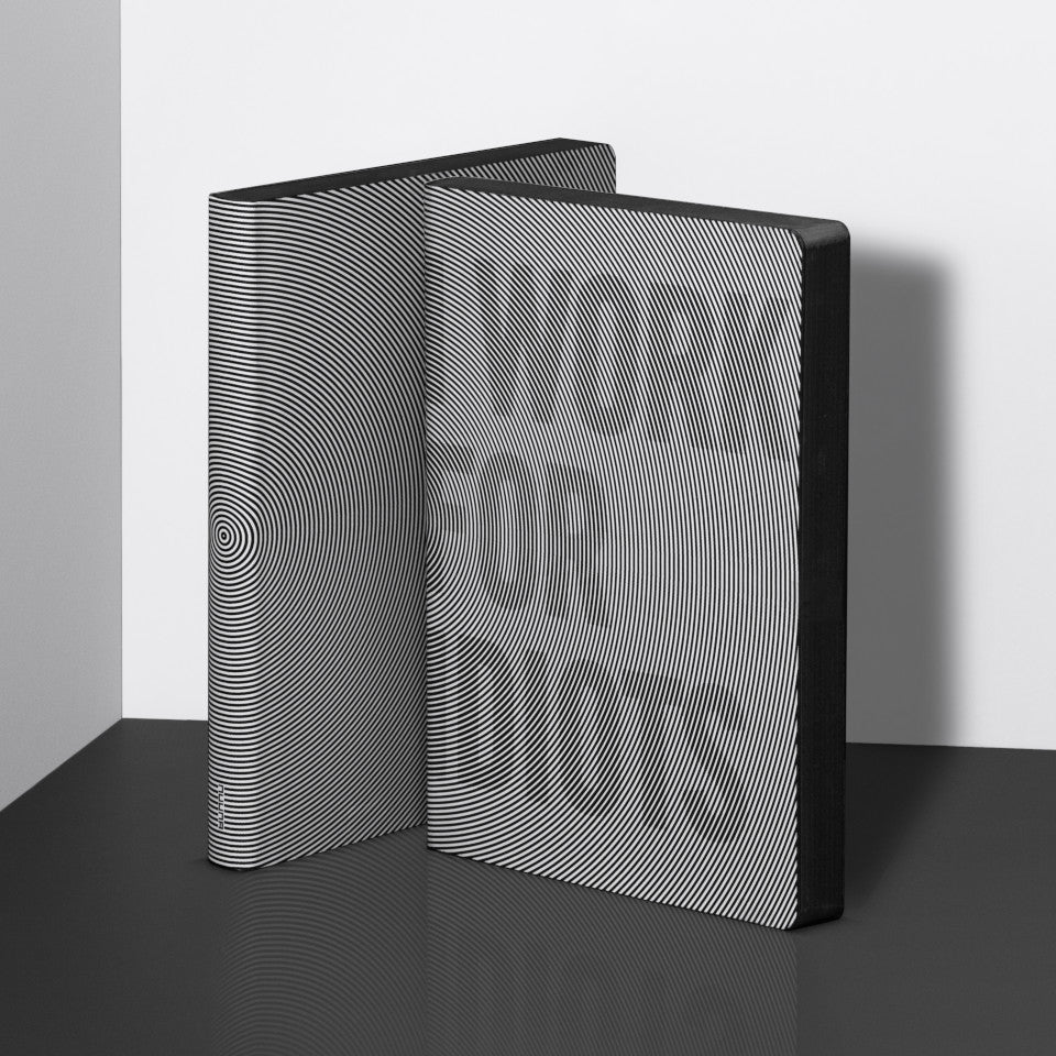 I Work For Idiots large notebook, styled standing with a second notebook.