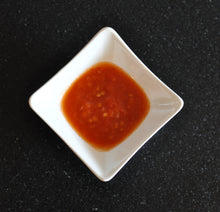 Load image into Gallery viewer, A ramekin of Professor Pods Kitchen Guru hot artisan chilli sauce - beautiful.