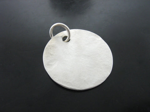 Hammered Disk Charm
