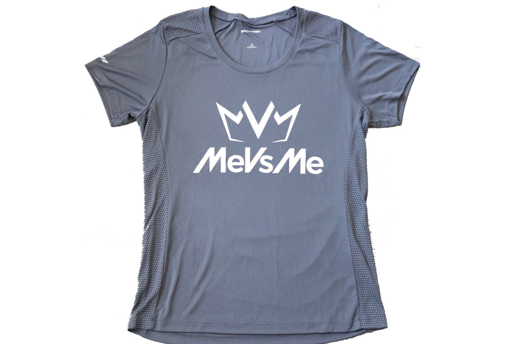 Frontside view of the iron grey Women's MVM Performance Tee with MeVsMe logos.