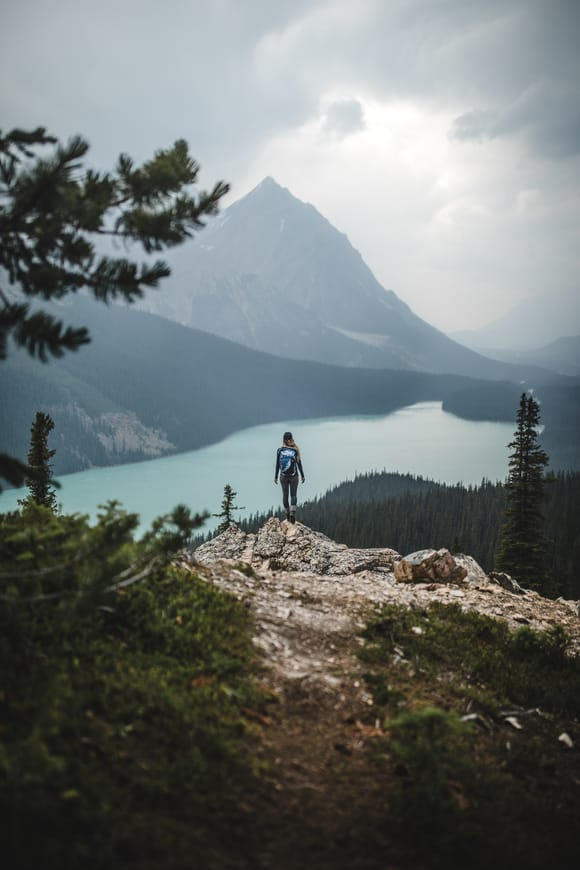 woman overlooking glacial lake
