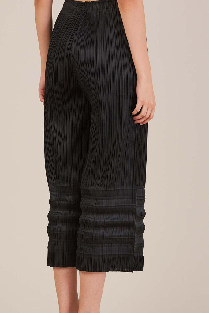 Pleated Under leg Trousers by Pleats Please by Issey Miyake