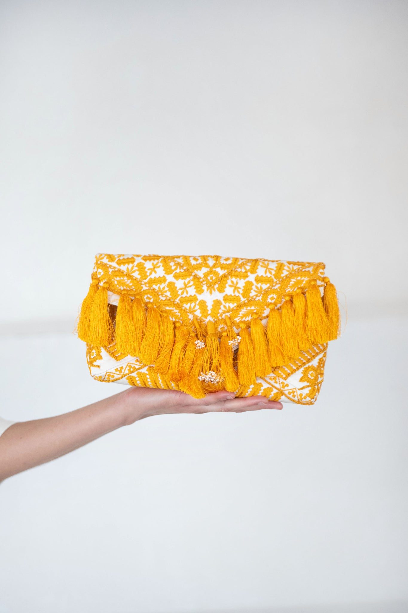 envelope tassel clutch, off-white and yellow
