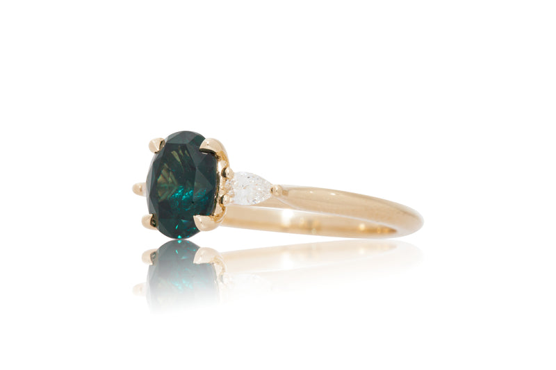 2.06CT. BLUE GREEN OVAL SAPPHIRE WITH PEAR SHAPE DIAMOND ACCENTS