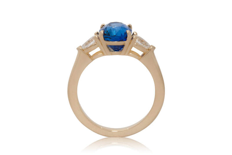 Oval Blue Sapphire with Pear Shape Diamond Accents