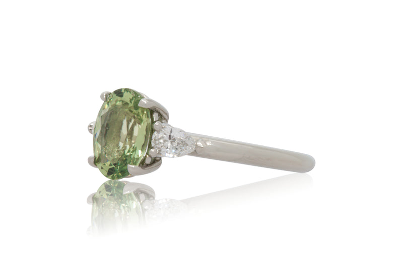 1.80ct. Lively, Light green sapphire with pear shape diamond accents