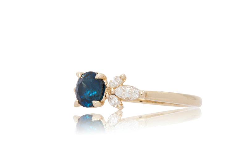 Round Blue Sapphire With Marquise Shape Diamond Clusters