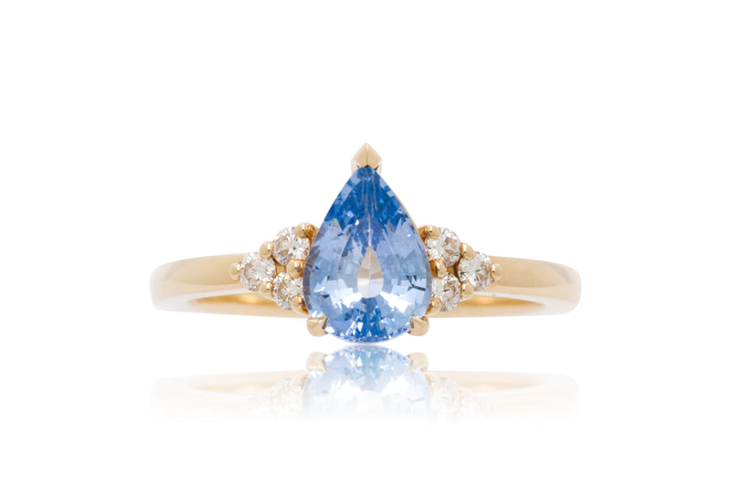 1.52ct. Pear Shape Blue Sapphire With Round Diamond Accents