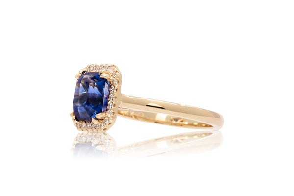 2.81ct. Lively Blue Step Cut Sapphire With A Diamond Halo