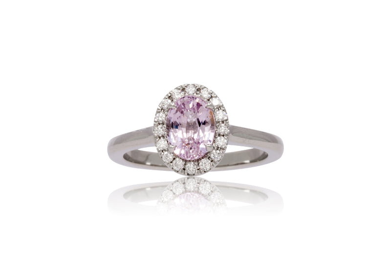 1.45ct. Oval Pink Sapphire With A Diamond Halo