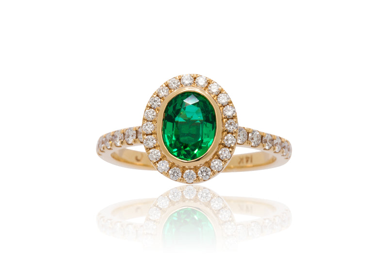 0.95ct. Oval Cut Zambian Emerald With A Diamond Halo