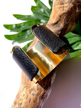 Load image into Gallery viewer, brass cuff with motorcycle leather accent